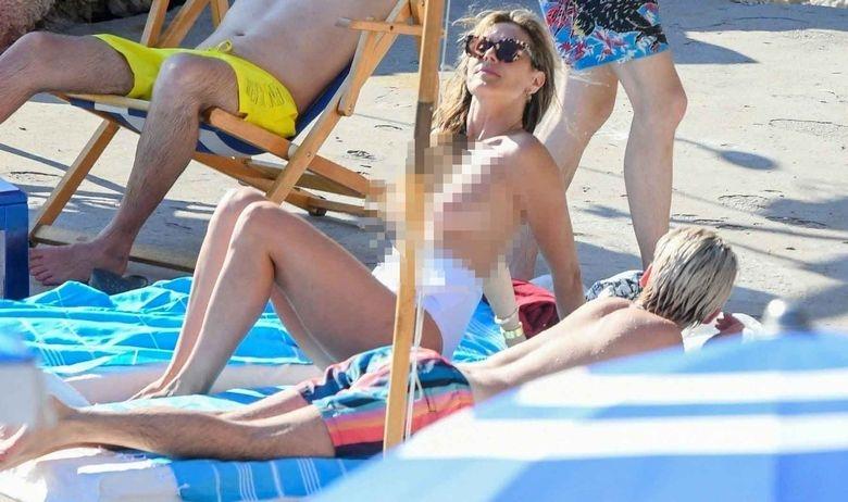 Хајди Клум топлес на плажа во друштво на децата и деверот