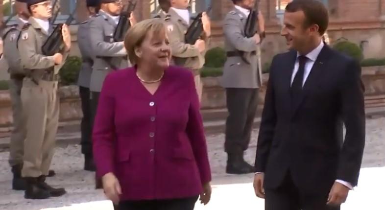 Почна средбата Макрон – Меркел, канцеларката ќе се обиде да го омекне ставот на Франција
